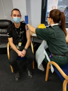 Critical Care Paramedic Laurie Philipson receiving vaccine